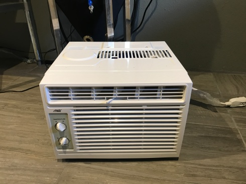 I bought a brand new 5,000 BTU AC unit from WalMart for $97.